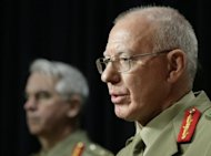Australian Defence Force chief David Hurley (R), seen here briefing the media on situation in Afghanistan, in Canberra, in 2010. An Australian special forces soldier has been killed in Afghanistan, Hurley said on Tuesday, bringing to 33 the number of Australians lost in the conflict