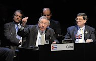 In a picture released by the Chilean Presidency, Cuban President Raul Castro (L) delivers a speech as his Foreign Minister Bruno Rodriguez looks on at the Latin American and Caribbean States (CELAC) Summit in Santiago, on January 28, 2013