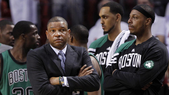 Boston Celtics head coach Doc Rivers, left, and Paul Pierce, right, watch during the final minutes of overtime in Game 2 in their NBA basketball Eastern Conference Finals playoff series against the Miami Heat, Wednesday, May 30, 2012, in Miami. The Heat defeated the Celtics 115-111 in overtime. (AP Photo/Lynne Sladky)