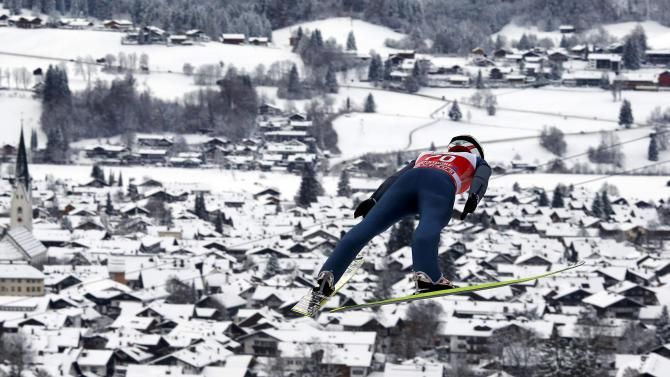 Ammann from Switzerland soars through the air during the trial round for the first jumping of the 63rd four-hills ski jumping tournament in Oberstdorf