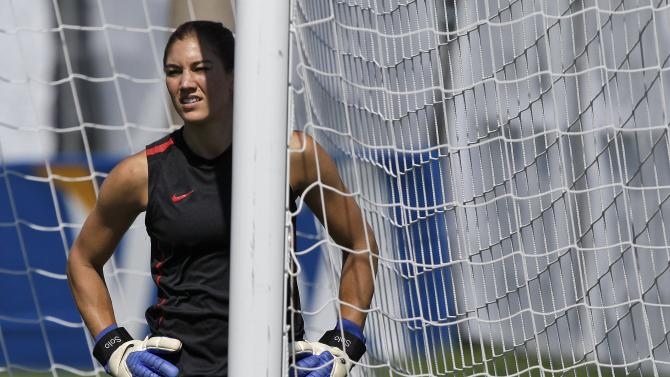 United States goalkeeper Hope Solo takes a break from a drill during a training session in preparation for a quarterfinal match against Brazil during the Women's Soccer World Cup in Dresden, Germany, Saturday, July 9, 2011. (AP Photo/Marcio Jose Sanchez)