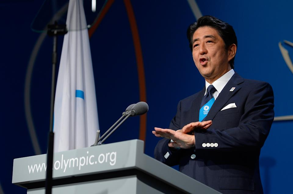 Japan's Prime Minister Shinzo Abe, addresses the International Olympic Committee session during the Tokyo 2020 bid presentation in Buenos Aires, Argentina, Saturday, Sept. 7, 2013. Madrid, Istanbul and Tokyo are competing to host the 2020 Summer Olympic Games.(AP Photo/Fabrice Coffrini, Pool)