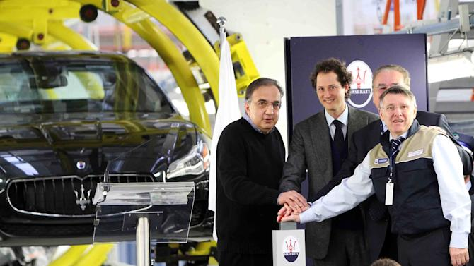"Fiat and Chrysler CEO Sergio Marchionne, left, stands by Fiat president John Elkann, during the unveiling of a Maserati plant in Grugliasco, near Turin, Italy, Wednesday, Jan. 30, 2013. Fiat SpA, the Italian automaker that controls Chrysler LLC, said Wednesday it stanched fourth-quarter losses in Europe last year, helping earnings more than double as North American sales continued to surge. The carmaker based in the northern city of Turin posted net profit of euro102 million ($138 million), up from euro 43 million in the same period last year as Fiat. Revenues were euro 21.8 billion. Fiat and Chrysler CEO Sergio Marchionne told analysts. ""it is my objective at the end of the process for Fiat and Chrysler to be one corporate entity."" (AP Photo/Daniele Bottallo, Lapresse)"