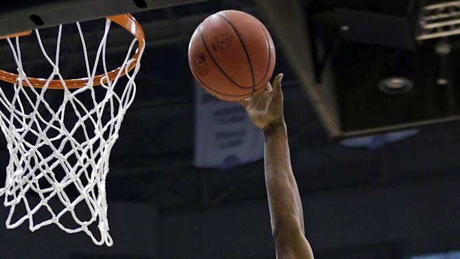 Wichita State's Cleanthony Early (11) shoots over Pittsburgh's Durand Johnson (5) during the first half during a second-round game in the NCAA college basketball tournament in Salt Lake City Thursday, March 21, 2013. (AP Photo/Rick Bowmer)