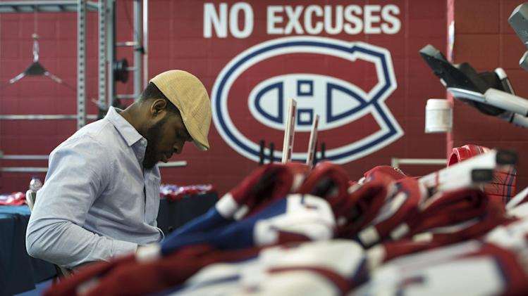 Montreal Canadiens' P.K. Subban signs souvenirs at the team's training facility Saturday, May 31, 2014 in Brossard, Quebec. The Canadiens were eliminated from the NHL hockey Stanley Cup playoffs by the New York Rangers in Game 6 of the Eastern Conference final on Thursday, May 29