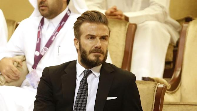 Former England footballer David Beckham attends the women's singles semi-final tennis match between Venus Williams of the USA and Victoria Azarenka of Belarus during the Qatar Open tennis tournament on February 27, 2015 in Doha