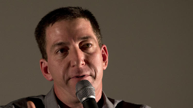 "Journalist Glenn Greenwald talks during a panel following the screening of the ""Dirty Wars"" documentary at the Rio Film Festival in Rio de Janeiro, Brazil, Saturday, Sept. 28, 2013. Greenwald, who has thousands of leaked National Security Archive documents, participated on a panel with American journalist Jeremy Scahill following the screening of the documentary ""Dirty Wars"" based on his book by the same name about covert operations. (AP Photo/Silvia Izquierdo)"