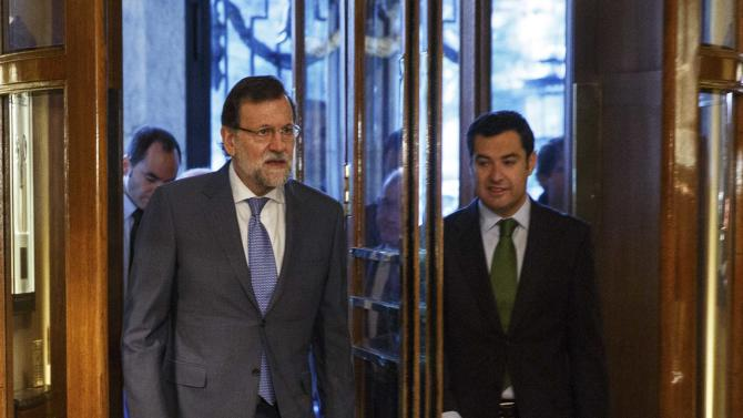 Spanish PM Rajoy arrives next to Andalusian regional PP leader Moreno for a political event in Madrid