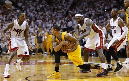 Indiana Pacers' Hill grabs the ball after he was fouled by Miami Heat's James as Miami's Chalmers and Wade look on during Game 2 of their NBA Eastern Conference final basketball playoff in Miami