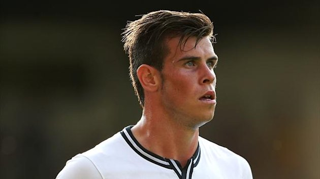 Gareth Bale will miss the first game of the season (PA Photos)