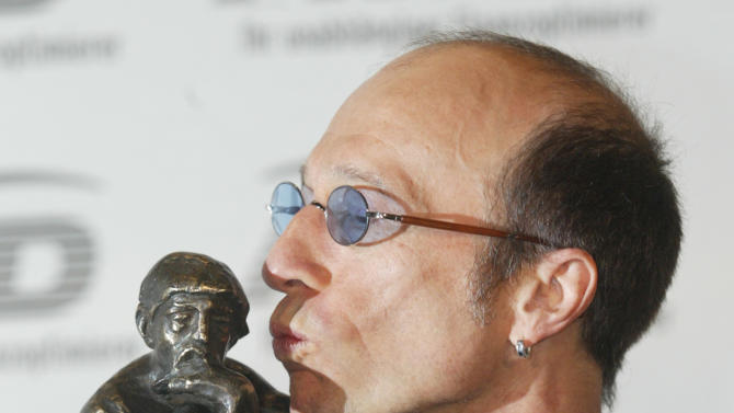 FILE - In this Oct. 22, 2003, file photo, musician Robin Gibb of The Bee Gees kisses his prize after he received it at the World Award ceremony in Hamburg, Germany. A representative said on Sunday, May 20, 2012, that Gibb has died at the age of 62. (AP Photo/Joerg Sarbach, File)