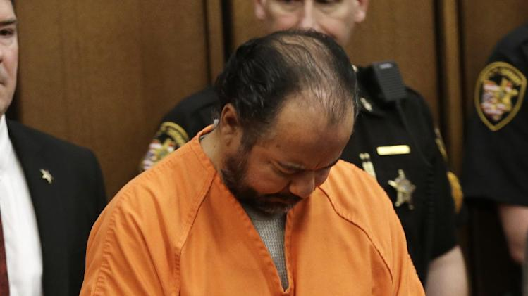 Ariel Castro walks into the courtroom for his arraignment Wednesday, June 12, 2013, in Cleveland. Castro, accused of holding three women captive in his Cleveland home for about a decade, pleaded not guilty Wednesday to hundreds of charges, including rape and kidnapping. He is charged with kidnapping three women and keeping them _ sometimes restrained in chains _ along with a 6-year-old girl he fathered with one of them.  (AP Photo/Tony Dejak)