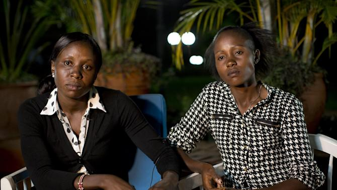In this photo taken Thursday, Feb. 4, 2016, Joy Sakari, a 400-meter runner, left, and Francisca Koki Manunga, a hurdler, right, who were both banned for doping at the 2015 world championships, speak exclusively to The Associated Press in the town of Embu, Kenya. The two Kenyan athletes serving a four-year ban for doping at the 2015 world championships say the chief executive of Athletics Kenya, the country's governing body for track and field, asked them each for a US dlrs 24,000 bribe to reduce their suspensions. (AP Photo/Ben Curtis)