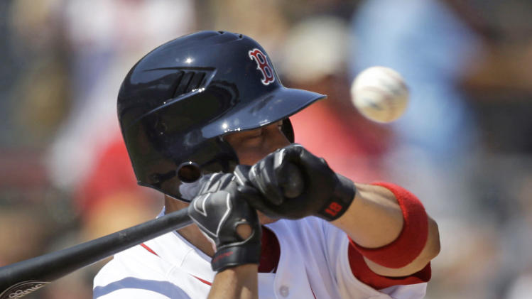 Boston Red Sox right fielder Shane Victorino avoids a high fast pitch in the third inning of an exhibition baseball game against the Tampa Bay Rays in Fort Myers, Fla., Monday, March 10, 2014. (AP Photo/Gerald Herbert)