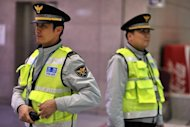 File photo shows police on patrol in Seoul. Two people including a Korean businessman in New Zealand have been arrested on suspicion of collecting intelligence on military equipment for North Korea, police said Thursday