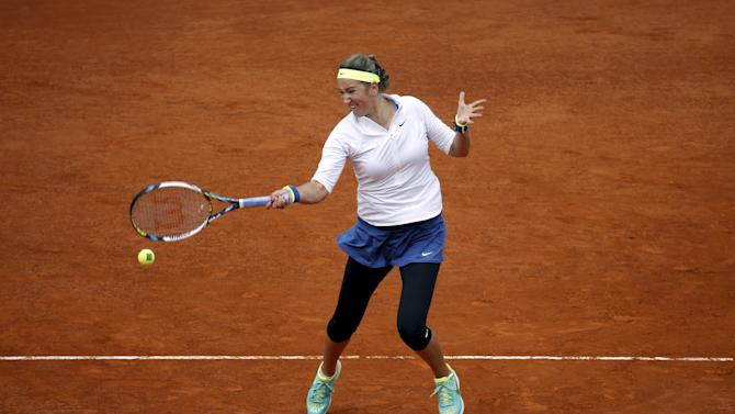 Azarenka of Belarus returns the ball to Williams of the U.S. during their match at the Madrid Open tennis tournament in Madrid