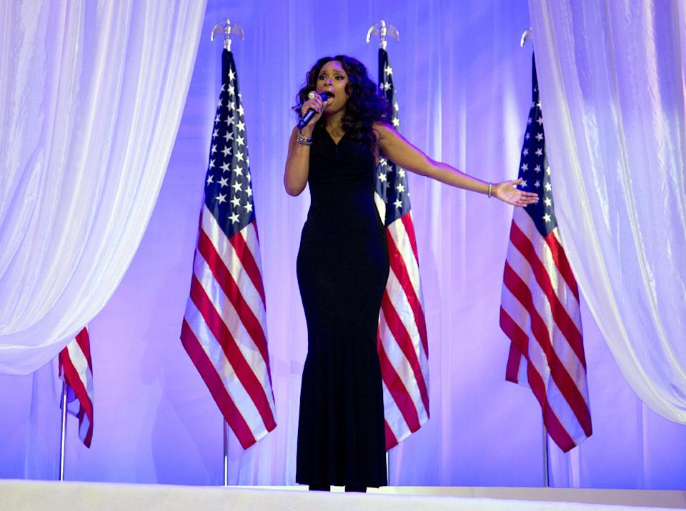 Jennifer Hudson sings as President Barack Obama and first lady Michelle Obama dance together at an Inaugural Ball, Monday, Jan. 21, 2013, at the Washington Convention Center in Washington,  during the 57th Presidential Inauguration. (AP Photo/Carolyn Kaster)
