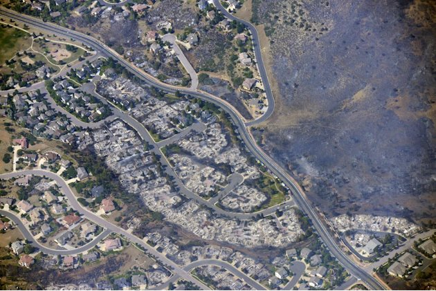 This aerial photo taken on Wednesday, June 27, 2012, shows burned homes in the Mountain Shadows residential area of Colorado Springs, Colo., that were destroyed by the Waldo Canyon wildfire. More than