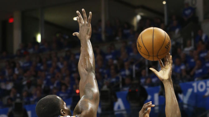 Houston Rockets guard James Harden (13) shoots in front of Oklahoma City Thunder center Kendrick Perkins (5) in the first quarter of Game 1 of their first-round NBA basketball playoff series in Oklahoma City, Sunday, April 21, 2013. (AP Photo/Sue Ogrocki)