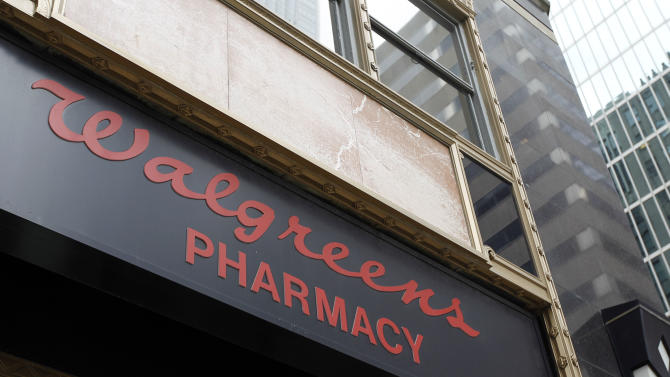 In this June 20, 2011 photo, a Walgreens pharmacy sign is displayed, in Philadelphia. Walgreen Co., the biggest drugstore chain in the U.S., said Tuesday, June 21, its profit grew 30 percent in the fiscal third quarter, and announced it is tangling with another major pharmacy benefits manager.(AP Photo/Matt Rourke)