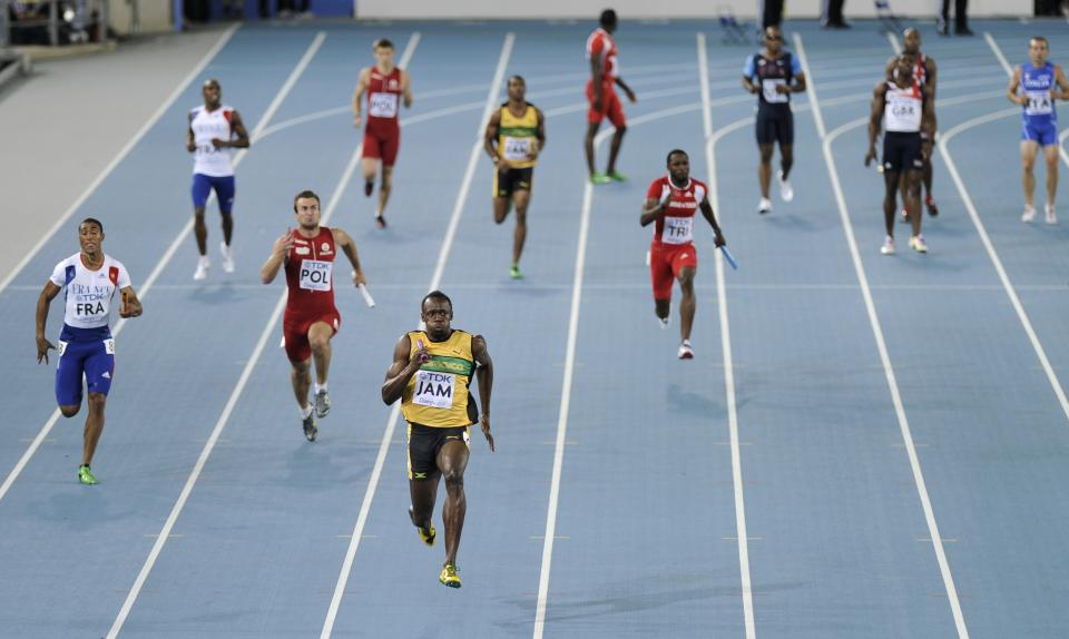 Jamaica's Usain Bolt, third from left in front, races to the finish line to win the Men's 4x100 Relay final at the World Athletics Championships in Daegu, South Korea, Sunday, Sept. 4, 2011. (AP Photo/Martin Meissner)
