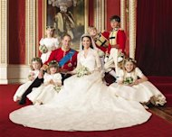 Britain's Prince William and his bride Catherine, Duchess of Cambridge, pose for an official photograph, with their bridesmaids and pageboys, on the day of their wedding, in the throne room at Buckingham Palace, in central London