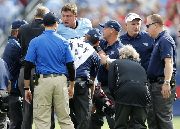 Tennessee Titans tackle David Stewart is helped onto a cart after breaking his right leg in the first quarter of an NFL football game against the Houston Texans, Sunday, Dec. 2, 2012, in Nashville, Te