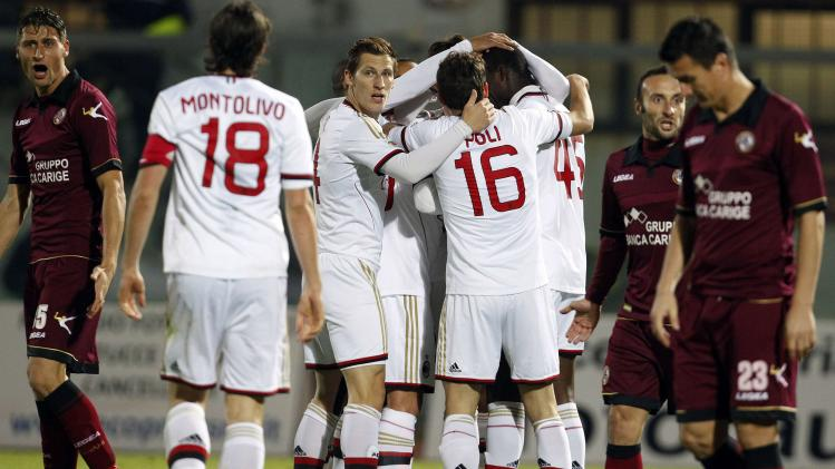 AC Milan's Balotelli celebrates after scoring against Livorno during their Italian Serie A soccer match in Livorno