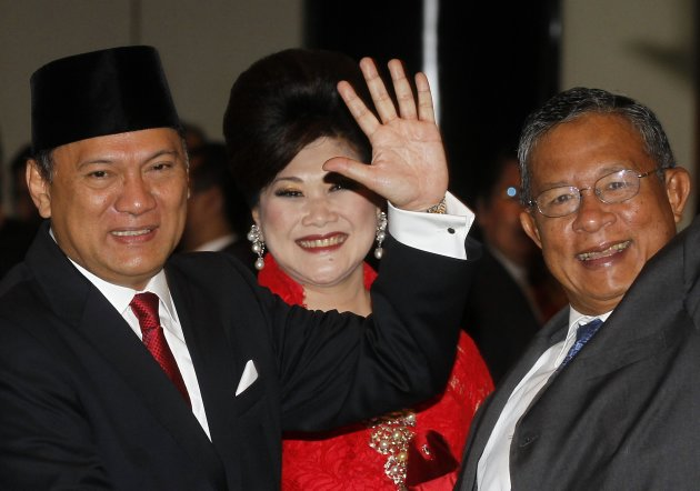 Indonesia's new central bank governor Martowardojo waves, as he stands next to his predecessor Nasution, after being sworn in, in Jakarta