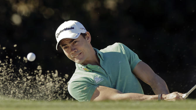 Camilo Villegas, of Colombia, hits from a greenside bunker on the second hole during the first round of the Humana Challenge golf tournament at the La Quinta Country Club in La Quinta, Calif., Thursday, Jan. 17, 2013. (AP Photo/Chris Carlson)