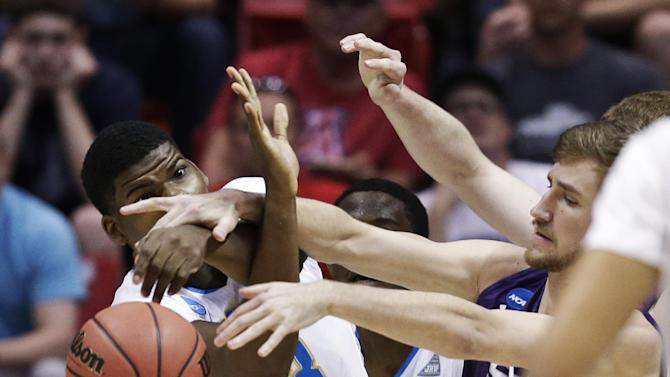 UCLA center Tony Parker, left, battles Stephen F. Austin forward Tanner Clayton for the loose ball during the first half of a third-round game in the NCAA college basketball tournament, Sunday, March 23, 2014, in San Diego. (AP Photo/Gregory Bull)