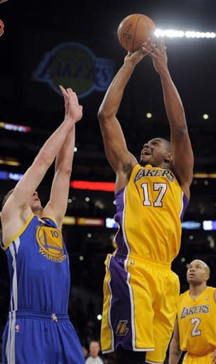Kobe scores 39 as weary Lakers hold off Warriors