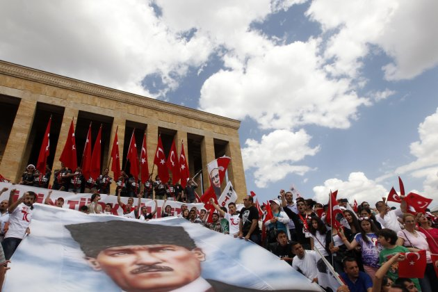 Demonstrators holding national flags shout slogans against Turkey's Prime Minister Tayyip Erdogan and his ruling Ak Party as they visit the mausoleum of Mustafa Kemal Ataturk in Ankara