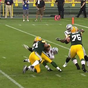 Green Bay Packers quarterback Aaron Rodgers sacked by Oakland Raiders defensive end LaMarr Woodley