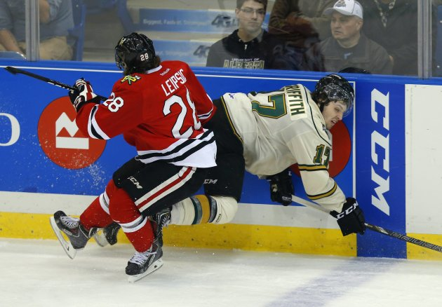 Portland Winterhawks' Leipsic checks London Knights' Griffith from behind for a penalty during the Memorial Cup Canadian Junior Hockey Championships in Saskatoon