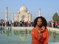 Oprah Winfrey poses in front of the Taj Mahal on January 19, 2012 -- Getty Images