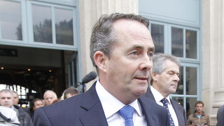 British Defence Secretary, Liam Fox, leaves  the Gare du Nord railway station prior to a meeting with his French counterpart, Gerard Longuet, in Paris, Wednesday, Oct. 12, 2011. A close friend of Britain's defence minister was questioned by government officials Tuesday in an investigation into the extent of the politician's ties to the former industry consultant. Defence Secretary Liam Fox has acknowledged he acted inappropriately in allowing former roommate and best man Adam Werritty, who previously ran a now-defunct defense consultancy called Security Futures, to join him on numerous overseas trips and to arrange a meeting in Dubai with a potential supplier. (AP Photo/Jacques Brinon)