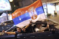 Supporters of Serbia&#39;s newly elected President and leader of Serbian Progressive Party (SNS), Tomislav Nikolic, celebrate his victory in the Serbian presidential run-off, in downtown Belgrade