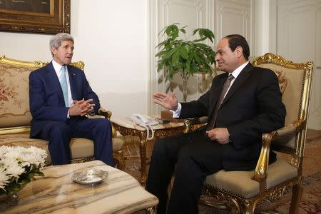U.S. Secretary of State Kerry speaks with Egyptian President Sisi in Cairo
