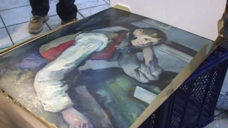 "A Serbian police display the masterpiece by French impressionist Paul Cezanne, ""The Boy in the Red Vest"" which they discovered in a vehicle  in Belgrade Thursday April 12, 2012 in this image taken from video released by the Serbian Interior Ministry.  The masterpiece by French impressionist Paul Cezanne, ""The Boy in the Red Vest""  which was stolen from a private Swiss museum in 2008 in one of the biggest art thefts in Europe,was discovered in Serbia, police said Thursday. Serbian police went on to say three people were arrested in connection with the robbery.(AP Photo/Serbian Interior Ministry/AP Video) TV OUT"