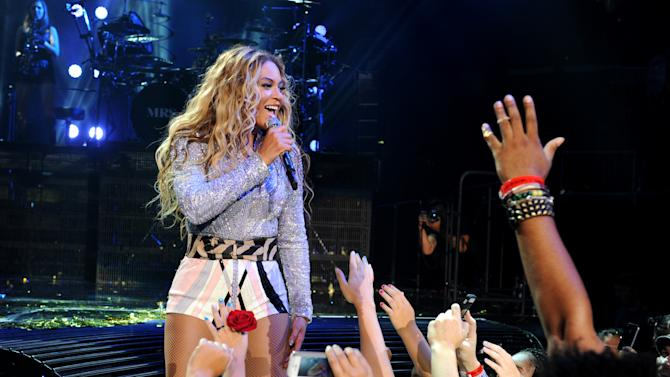 """IMAGE DISTRIBUTED FOR PARKWOOD ENTERTAINMENT - Singer Beyonce performs on her """"Mrs. Carter Show World Tour 2013"""" at Staples Center on Monday, July 1, 2013, in Los Angeles. Beyonce is wearing a lilac jacket and boots by Pucci. (Photo by Frank Micelotta/Invision for Parkwood Entertainment/AP Images)"""