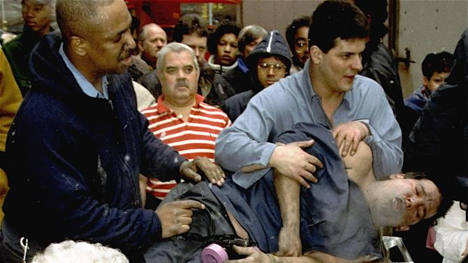FILE - In this file photo of Feb. 26, 1993, Victims of a fire at the World Trade Center in New York are treated at the scene after an explosion rocked the complex. Twenty years ago a group of terrorists blew up explosives in an underground parking garage under one of the towers, killing six people and ushering in an era of terrorism on American soil. (AP Photo/Marty Lederhandler, File)