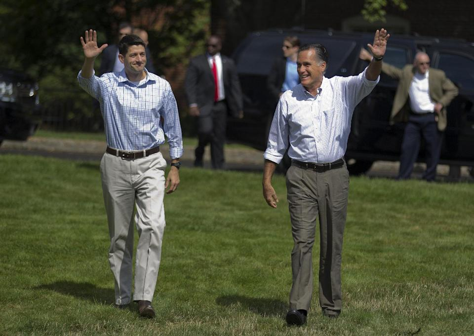 Republican presidential candidate, former Massachusetts Gov. Mitt Romney, right, and vice presidential running mate Rep. Paul Ryan, R-Wis., arrive for a campaign rally, Monday, Aug. 20, 2012, in Manchester N.H.  (AP Photo/Evan Vucci)