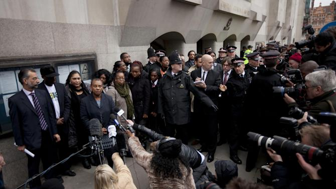 FILE- Doreen Lawrence, fourth left at microphones, the mother of murdered black teenager Stephen Lawrence, speaks to the media outside the Central Criminal Court in London, in this file photo dated Wednesday, Jan. 4, 2012, following the sentencing two men for the racist stabbing to death of 18-year-old Stephen Lawrence in 1993. British Prime Minister David Cameron is calling for an immediate investigation into allegations that former undercover police officer Peter Francis was ordered to smear the reputation of the family of murdered black teenager Stephen Lawrence Downing Street officials said Monday June 24, 2013, after newspaper allegations that a police officer infiltrated anti-racism protest groups to gain information that could discredit the Lawrence family. (AP Photo/Matt Dunham, File)