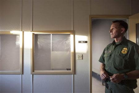 Acting Patrol Agent in Charge Widner explains the details of a temporary holding facility at the U.S. Department of Homeland Security's FOB Hedglen located southeast of Douglas