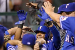Holland outpitches Wilson, Rangers top Angels 6-2