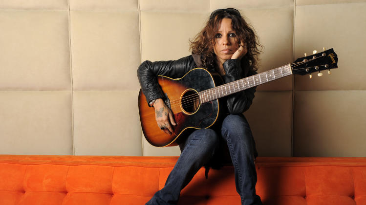 """FILE - This March 8, 2011 file photo shows musician and former lead singer of 4 Non Blondes Linda Perry in Los Angeles. The 90's rock group will reunite for one night on May 10 for the """"An Evening with Women"""" event supporting the L.A. Gay & Lesbian Center. (AP Photo/Chris Pizzello, File)"""