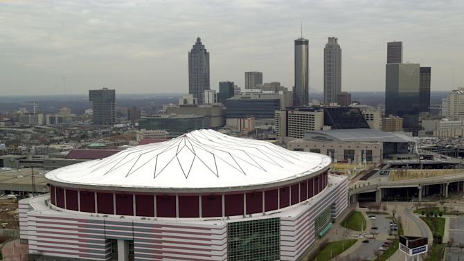 FILE - This Feb. 28, 2001 file photo shows an aerial view of the Georgia Dome in Atlanta.  Authorities say a 20-year-old man who plunged about 35 feet from the Georgia Dome's upper level and struck another fan during the Tennessee-North Carolina State college football game has died. The man fell on another football fan seated in the mezzanine area Friday, Aug. 31, 2012. The Georgia World Congress Center Authority, which operates the downtown football stadium, said in a statement.  (AP Photo/Atlanta Journal-Constitution, Rich Addicks)