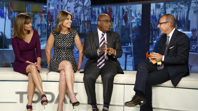 "This Sept. 25, 2012 photo shows ""Today"" show co-hosts, from left,  Natalie Morales, Savannah Guthrie, Al Roker and Matt Lauer during a broadcast in New York.  The morning show is finding itself on shaky ratings ground. After 15 years at the top, it's been falling behind ABC's ""Good Morning America"", but remains an advertising magnet. (AP Photo/NBC, Peter Kramer)"