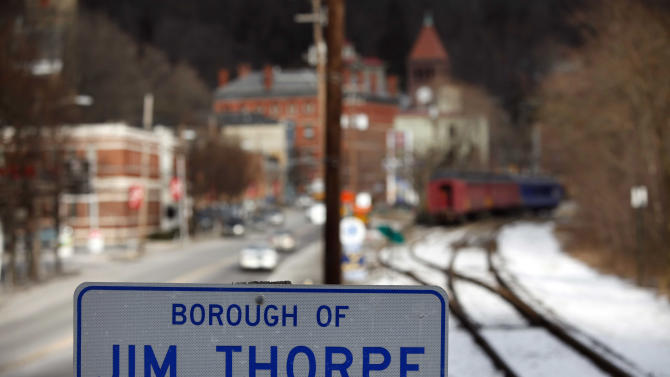 FILE - In this Jan. 12, 2010 file photo, a sign in the town of Jim Thorpe, Pa., is shown. The surviving sons of famed American Indian athlete Jim Thorpe won a crucial legal victory in April 2013 that put them close to their goal of bringing their father's remains from the Pennsylvania town named for him to tribal lands in Oklahoma, where he was born. But the town of Jim Thorpe isn't letting its Olympian namesake go without a fight. Residents and business owners are helping to raise money for the town's appeal, saying they have honored, appreciated and respected a man long considered one of the 20th century's best athletes. (AP Photo/Matt Rourke, File)